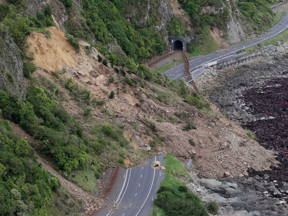 kaikoura-near-the-quakes-epicentre-has-been-cut-off-by-landslides-this-image-shows-the-damage-to-state-highway-one-and-the-main-railway-line-north-of-the-town
